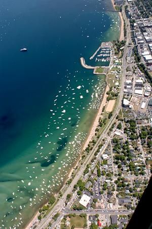 The beaches of West Grand Traverse Bay during the National Cherry Festival in…