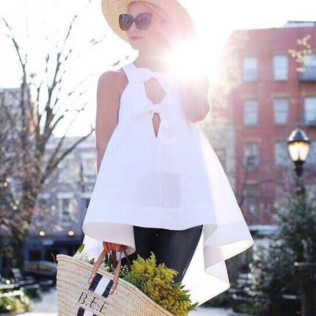 Now you've seen the light – flowing shapes and intricate necklines make spring's tops far from boring. #Shop @blaireadiebee's bright @rosie_assoulin look pc: @blaireadiebee