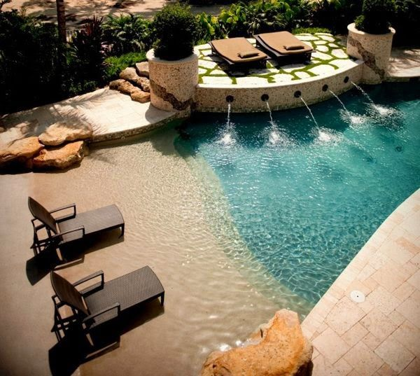 Pool that looks like a beach - mine will not require fountains or large boulders!!