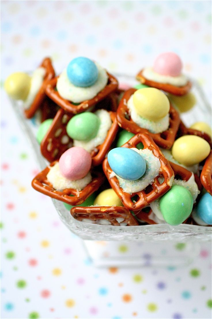 Easter Peanut Butter Buttons....  Servings: 50 pieces...         Ingredients:    50 mini-pretzels (**I used Hanover's Butter Snap);  1 cup white candy melts, melted (**Use your microwave and stir every 10 seconds or so after heating to make sure they melt completely);   50 Reeses Pieces pastel eggs;  Pastel sprinkles, for garnish