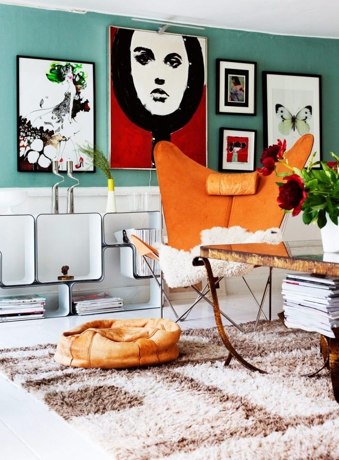 Loads of colour but the absence of a lot of pattern keeps it calm and serene the neutrals and metals add elegance...