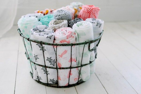 Genius nursery organization tips: Keep blankets and other important bedtime items where you can find them, like this basket at Thrifty Littles