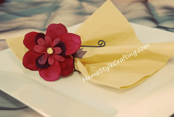 Homemade napkin rings from rolled wire.