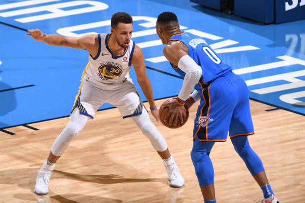 Russell Westbrook of the Oklahoma City Thunder handles the ball against the Golden State Warriors during the game at the Chesapeake Energy Arena on...