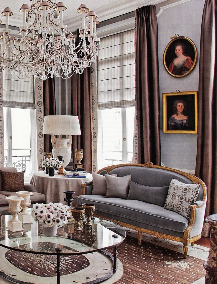 Floor-to-ceiling silk taffeta curtains, a crystal chandelier, antique French furnishings, and plenty of gold make this Paris apartment totally glamorous.