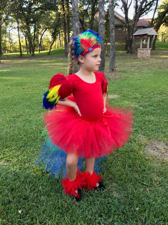 Birds of a feather flock together! This listing is for the red macaw parrot tutu skirt only. It is long in the back with tiers of blue, green, yellow and red tulle. It has red FEATHERS on the back too, making this parrot costume come to life! The red, short tutu skirt in front, is very full.