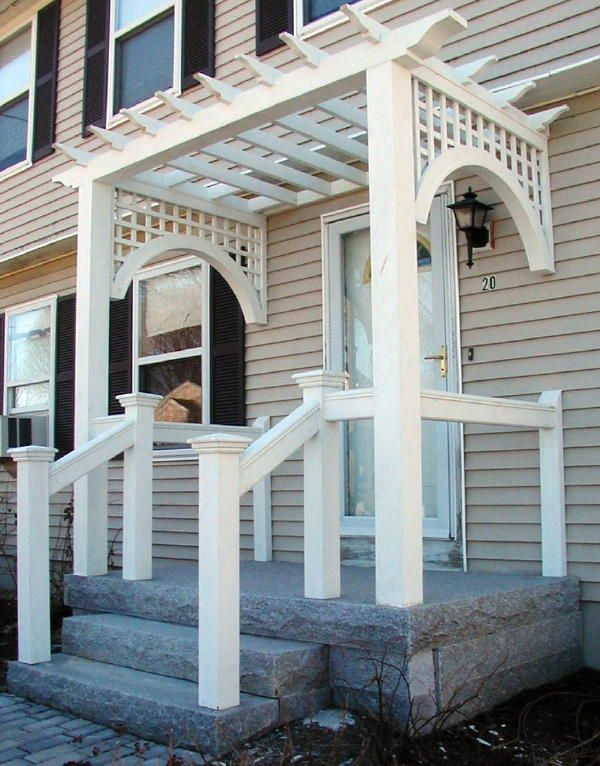 Pergola over front door. Wow, take off the lattice on the sides and all the railing!