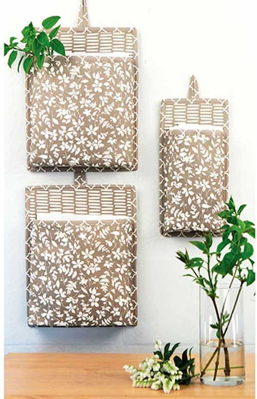 Store and organize your loose scissors, tape, notes and more, and keep them within reach with these fabric wall buckets. These clever wall hangings will st