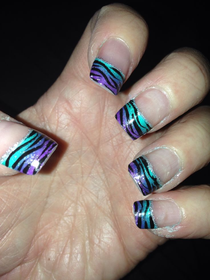 purple and teal nails finger