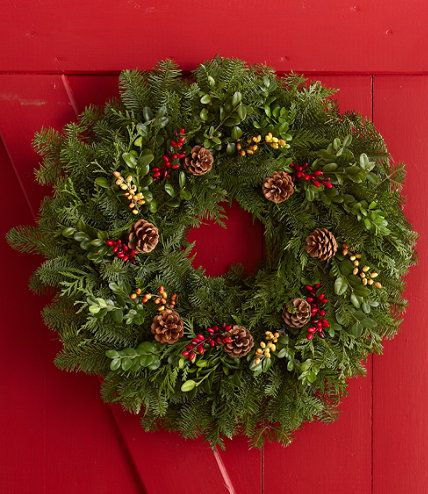 Woodland Berry Wreath:Natural pinecones and faux green and red berries adorn a full arrangement of noble fir, western red cedar and green boxwood. Includes a convenient over-the-door hanger.  Free Shipping from L.L.Bean