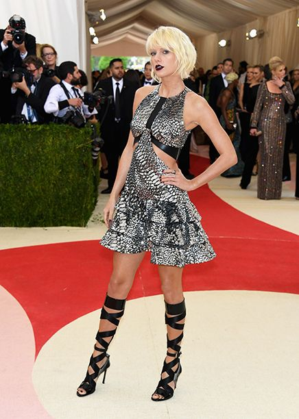 """MOST OUTRAGEOUS: Taylor Swift–she truly committed to her new Vogue-worthy makeover. The """"Style"""" singer stepped out from classic looks in a silver Louis Vuitton dress with cutouts, paired with lace-up gladiator heels."""
