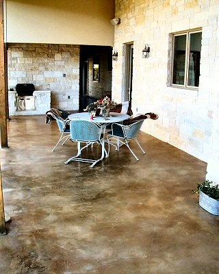 Love the color of the stained concrete. Alternative to carpet for basement finishing project.