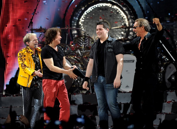 Singer David Lee Roth, musicians Eddie Van Halen, Wolfgang Van Halen and Alex Van Halen of Van Halen perform at their dress rehearsal for family and friends at the Forum on February 8, 2012 in Inglewood, California.  How cute it this :)