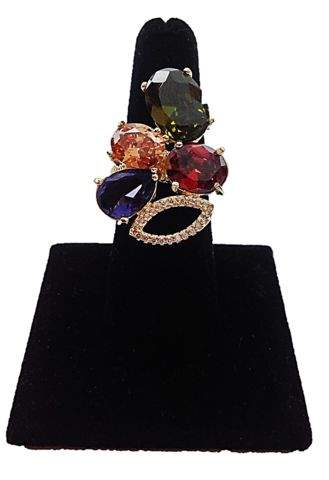 A unique, twisted setting #ring that features violet, yellow, and red cubic zirconias playing together in the light, for a brilliant display of icy fireworks.