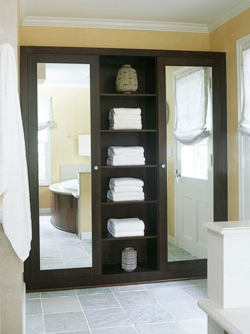 fantastic idea....full length mirror in the bathroom on front of a cabinet -- awesome idea for the girls bathroom linen closet!!