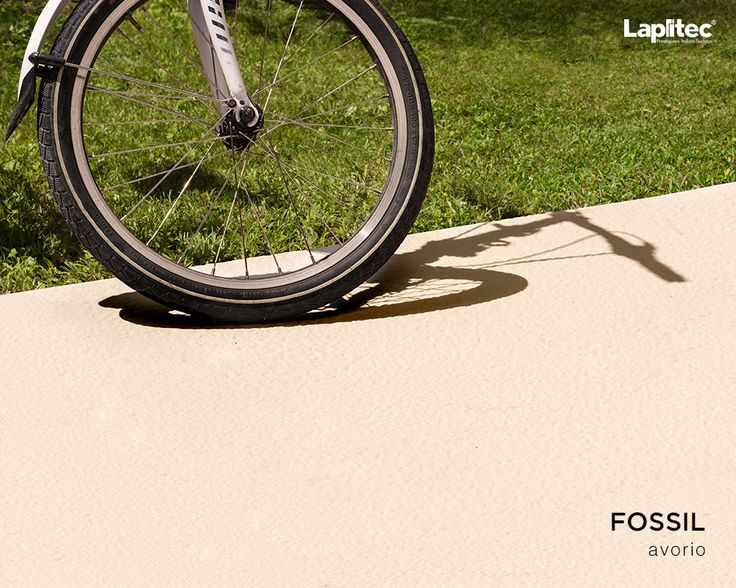 Sometimes a bumpy ride is a good thing. The substantial texture of Lapitec®'s Fossil finish in Avorio makes a perfect non-slip surface for outdoor patios.