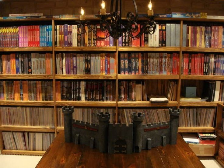 As someone who still fondly remembers cracking open boxes housing 20 sided dice, creating detailed character sheets and adventuring through imaginary worlds of fantasy realms, I admit the kid in me more than admires this attic-turned-D&D game room. It took 2 years to complete and showcases exemplary organization, housing a myriad of surprises, that we dare say, seems magical!