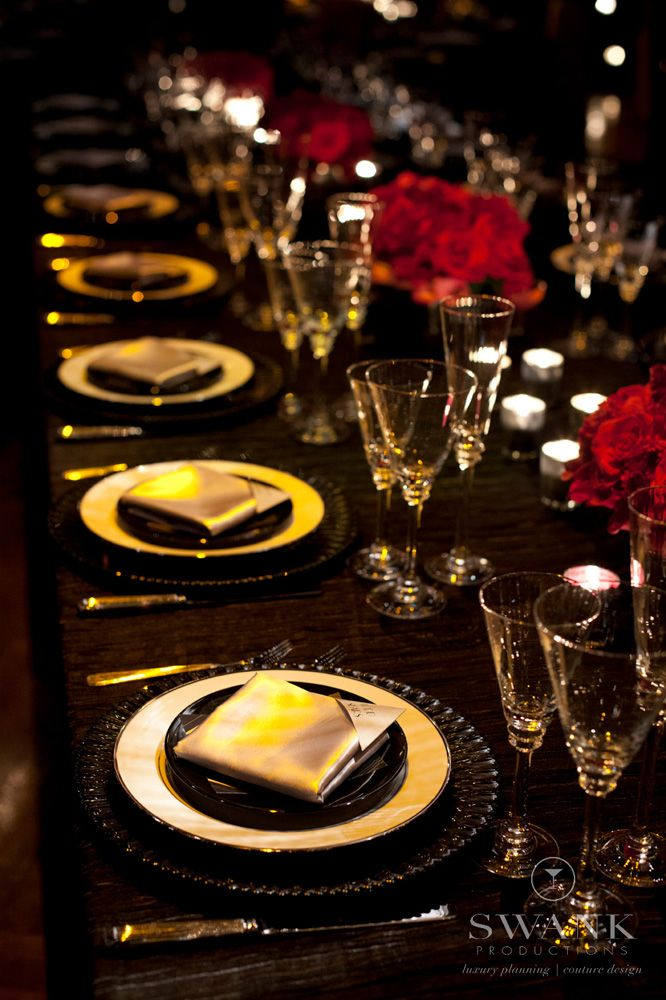 Pink and black deco wedding at the Edison Ballroom NYC. Red/ Pink and Gold Reception Decoration and Table Settings