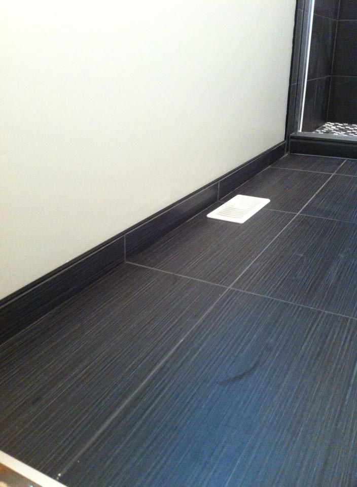Tex Black 13x26. Tiled baseboards look great and are ideal for bathroom areas.