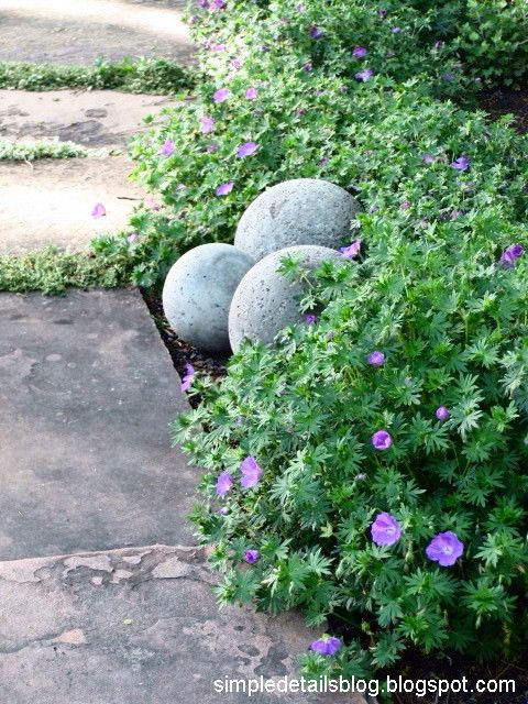 """""""DIY Concrete Garden Spheres ... They look just like  Restoration Hardware's Spheres - using concrete and lighting globes from the thrift store, a bargain at $10 for five of them!"""""""