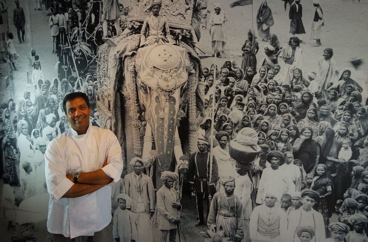 Chef Mohammed with the famous Malabar murals