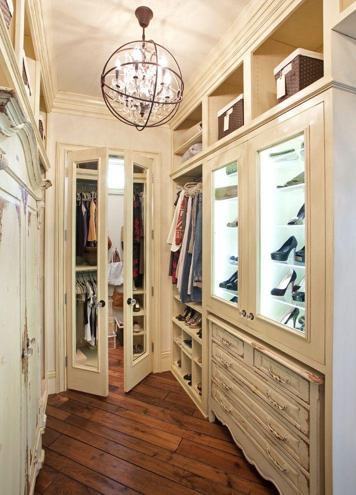 traditional rustic walk in closet organizer including glass door shoes shelves hanging sections upper open shelves dark wood flooring idea of Dozens of Walk In Closet Organizers Lowes
