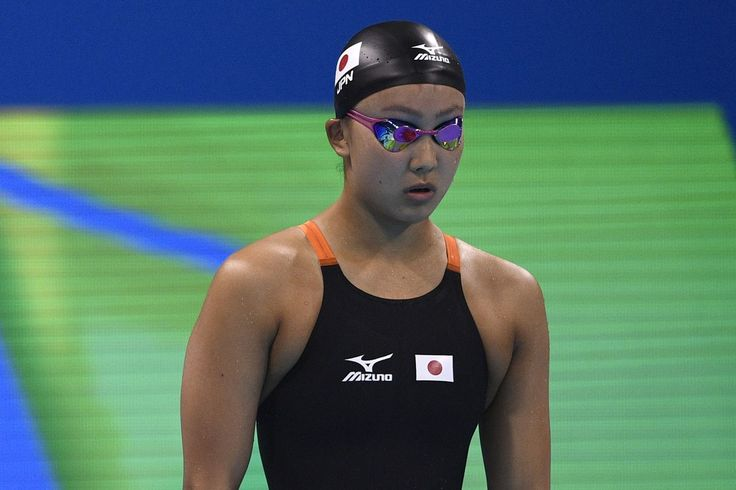 Japan's Kanako Watanabe prepares to take part in the Women's 100m Breaststroke heats during the swimming event at the Rio 2016 Olympic Games at the Olympic Aquatics Stadium in Rio de Janeiro on August 7, 2016. / AFP / Martin BUREAU