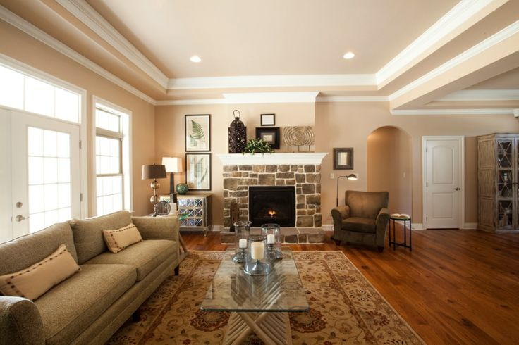 Fireplace As The Focal Point In The Room With Stone Veneer And A Raised Hearth Hardwood