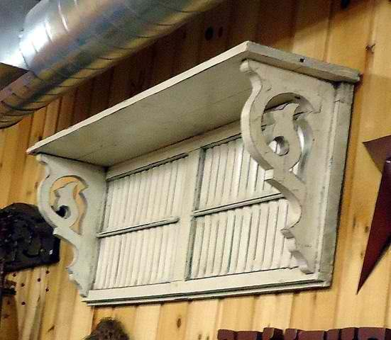 Repurposed -- Turn an old shutter into a shelf. I love these brackets and could cut some from scrap wood using my scroll saw.