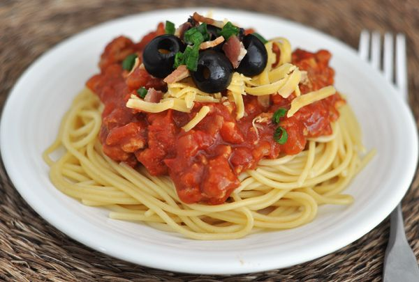 Cowboy spaghetti is not your regular old spaghetti. The sauce is still red, but the flavors are smoky and tangy, slightly sweet, and absolutely delicious.