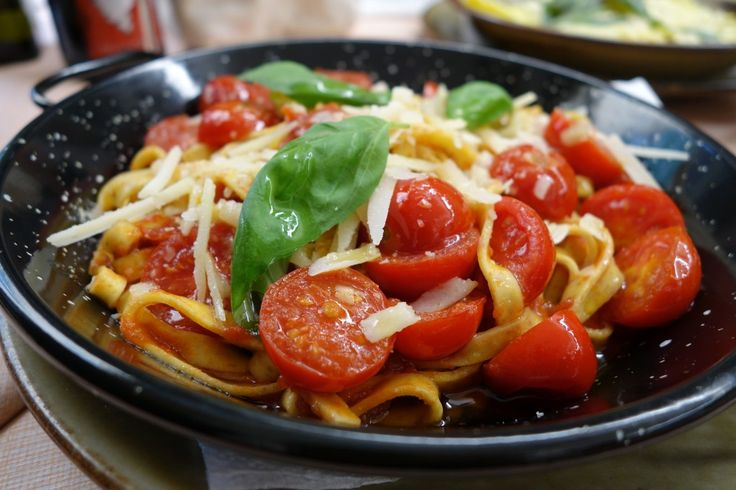 Simple homemade pasta with tomatoes and grated cheese