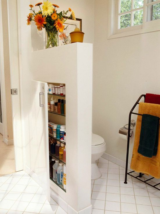 Using a partial wall with inside storage. Awesome idea to utilize what bathroom space you have.