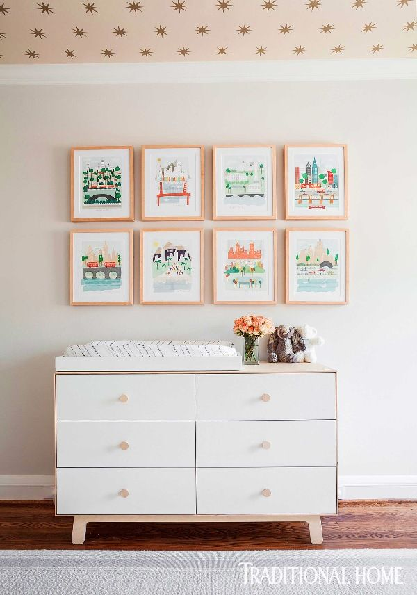 A collection of prints depicting city skylines was purchased on Etsy and hangs above a new midcentury-style chest of drawers acting, for now, as a diaper-changing station.- Photo: Julie Soefer / Design: Marie Flanigan