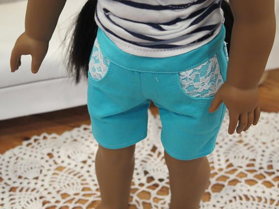 Knee length aqua shorts with lace pockets by RainbowLilyDesigns on Etsy. Made with the Jeans Bundle Pattern. Get it here https://www.pixiefaire.com/products/liberty-jane-jeans-bundle-for-ag. #pixiefaire #jeansbundle