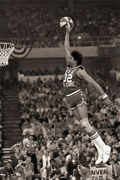 Julius Erving of the Philadelphia 76ers attempts a dunk during the 1976 NBA Slam Dunk Contests.