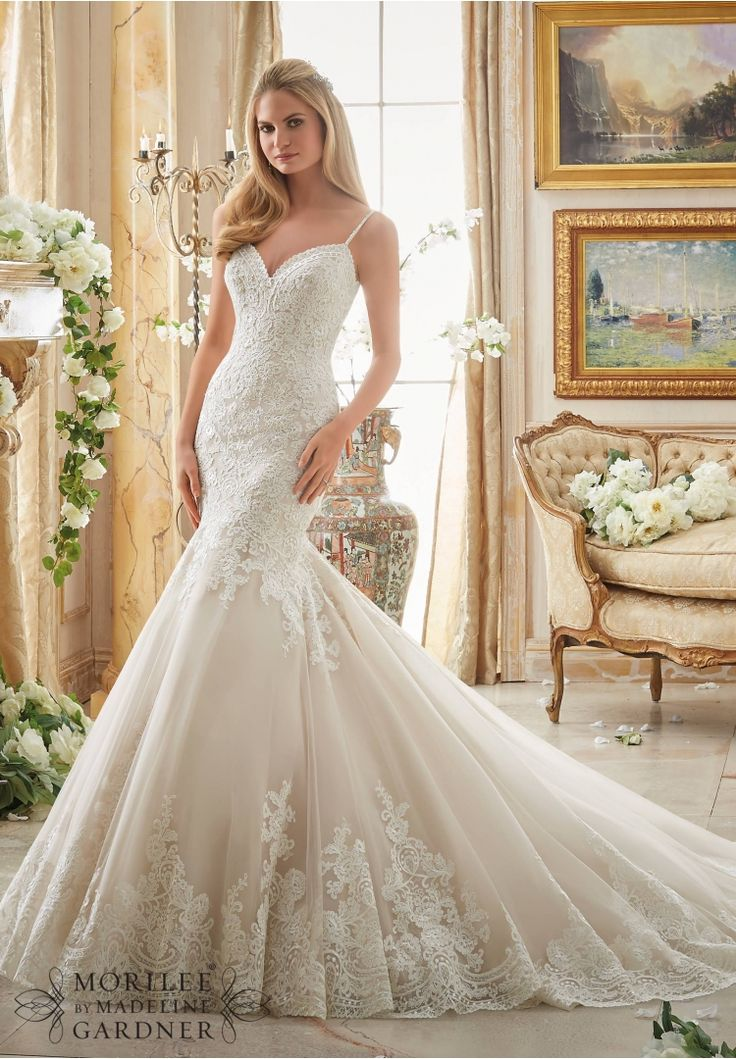 Wedding Dresses and Wedding Gowns by Morilee featuring Alencon Lace Appliques on Tulle with Wide Scalloped Hemline Available in Three Lengths: 55, 58, 61. Colors Available: White, Ivory, Ivory/Champagne