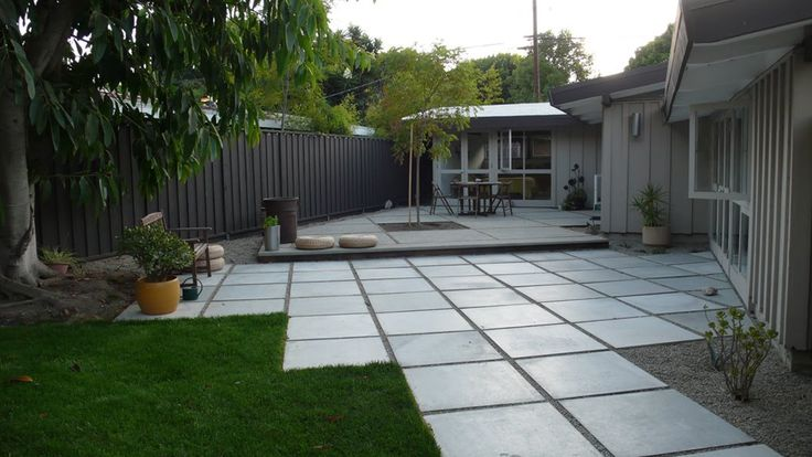 gridded cement paver patio