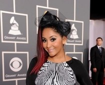 Snooki's 2012 Grammy look...that hair bow is a hair don't #snooki #Grammys #redcarpet #hair #fashion #style #jerseyshore