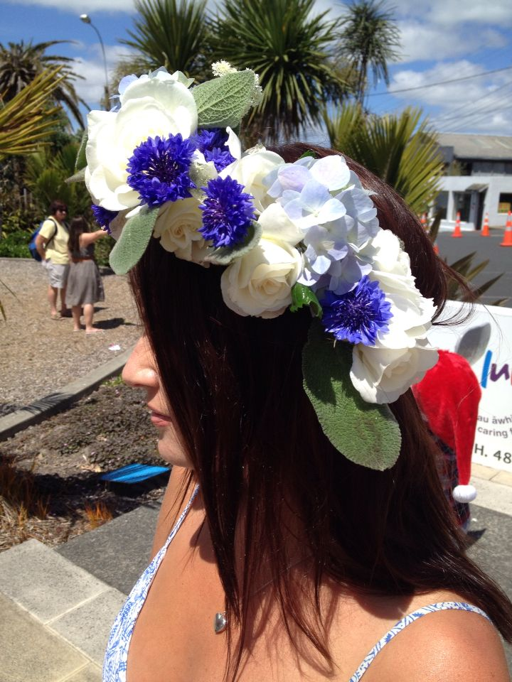 Floral head wreath of white iceberg roses, blue cornflowers and lambs ears