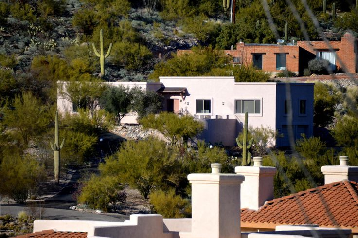 Welcome to 5635 E. Via Arbolada nestled in the foothills of the Catalina mountains. This 2,727 square foot home reflects the serenity of its desert surroundings. Enjoy the breathtaking mountain and city views from the front patio with fountain or from spacious living room through the large banks of recently upgraded Energy Star windows. Set far back from the road on over 1 acre, this home offers privacy and peace. Three bedrooms feature high ceilings and lots of space. Backyard includes…