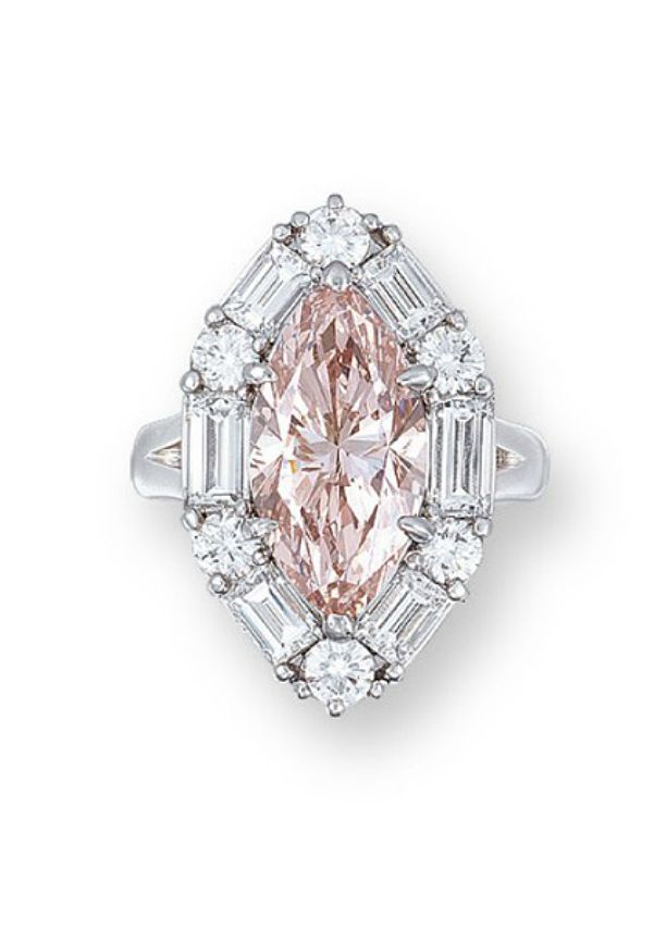 A COLOURED DIAMOND AND DIAMOND RING Set with a marquise-cut fancy brownish orangy pink diamond weighing 5.00 carats, within a brilliant and baguette-cut diamond surround, mounted in platinum