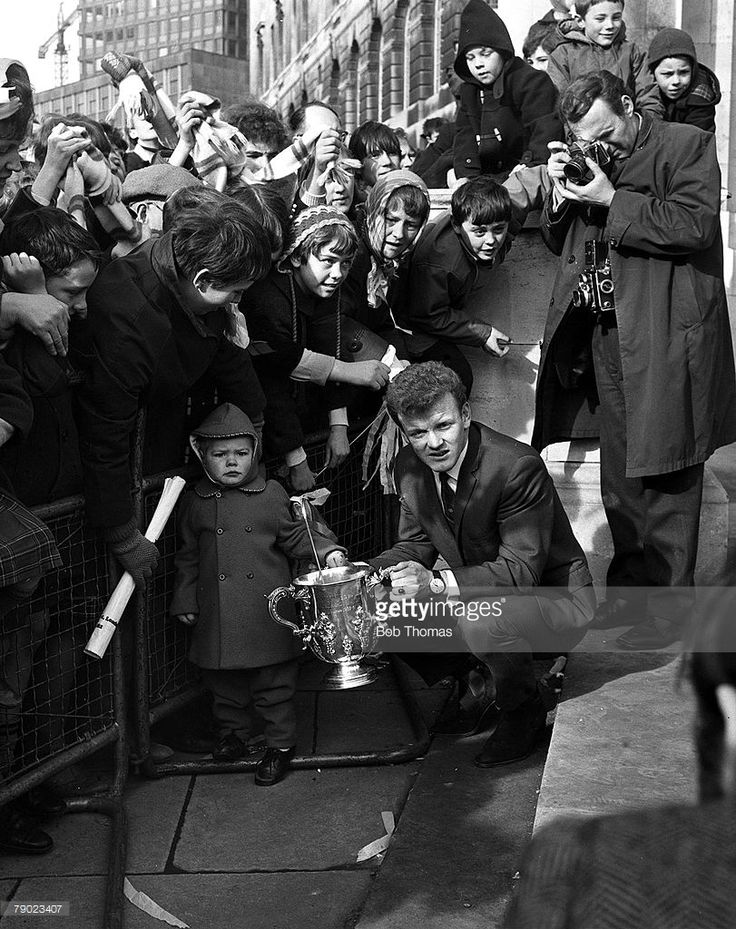 March 1968, League Cup Final, Leeds United 1 v Arsenal 0, The League Cup winners Leeds United return home with the trophy, Captain Billy Bremner shows the trophy to the fans gathered at the Town Hall