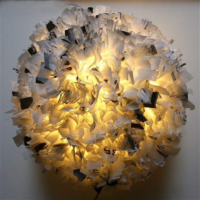a gorgeous pendant light, made from recycled plastic grocery bags!!