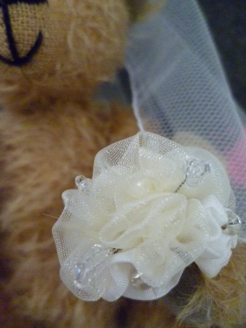 A close up of the wedding bear's bouquet. The colours can be customisable.