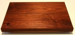Walnut Chopping Board, 430mm X 290mm X 38mm. Solid Walnut chopping board with anti bacterial oil finish.  The oil finish is guaranteed to keep your board from drying out giving you a quality product for many years of use. The board is reversible with handles recessed into one side.