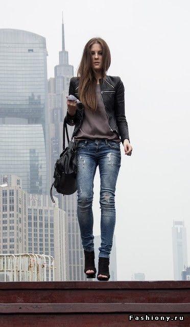Distressed denim, leather jacket, soft tee.
