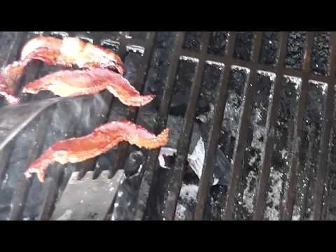 Firming Up Smoked Bacon Over Lump Charcoal.  This is how I firmed up smoked bacon on a grill.  After smoking bacon for a few hours in a Brinkmann Electric Smoker, it still needs to be firmed it up.  I fry the bacon on the hot cat-iron grills in my charcoal grill.  Please share and enjoy my other BBQ smoking videos too!