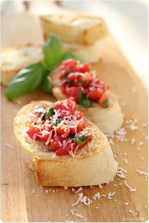 Best.  Bruschetta.  Ever.  Recipe for bruschetta- super tasty, and an easy garlic spread for your baguette!