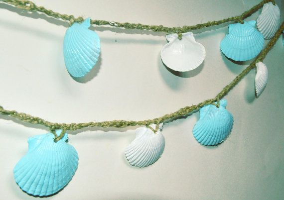 Hand made seashell garland with 2-3 inch scallop sea shells. The seashells have been drilled, painted light blue and white and secured to hemp cording