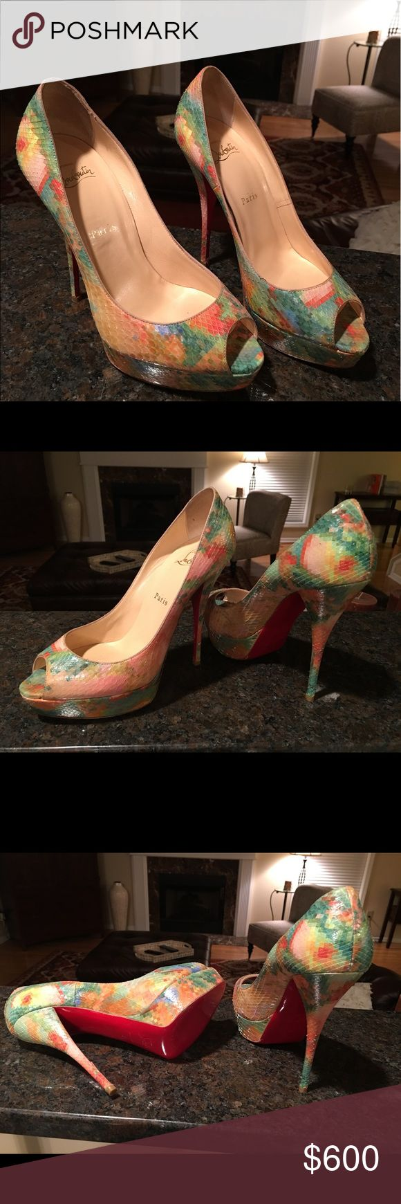 Christian Louboutin Troca 140 Python Pixel size 39 Pre-owned.  In good condition. Minor damage on heel, a scrape and one scale is lifted a little because of it. Please see pictures.  Fits 8.5 - 9 US Christian Louboutin Shoes Heels